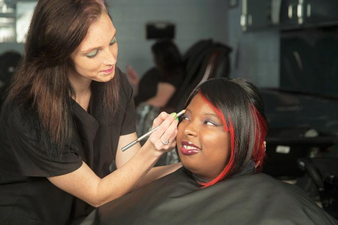 Students practicing cosmetology